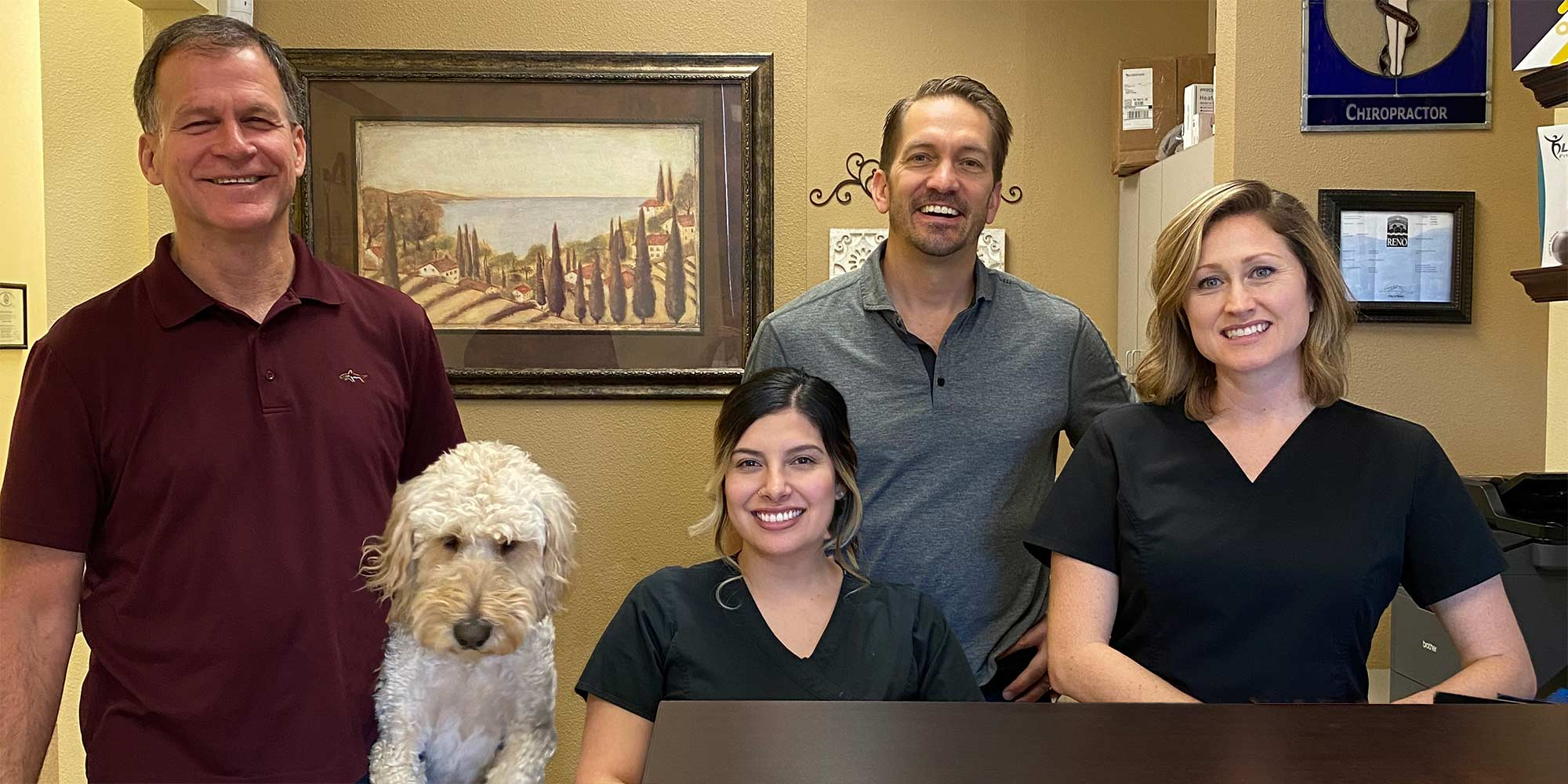 Chiropractor Reno NV David Berg and His Team with Dog